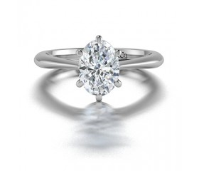 Classic Solitaire Oval Diamond Engagement Ring In 14K White Gold comprised of 1.50ctw